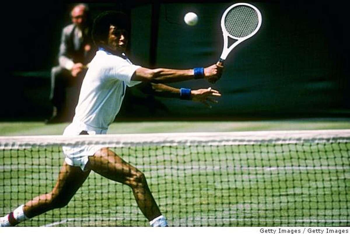 Arthur Ashe runs for the ball during a match at Wimbledon in England.