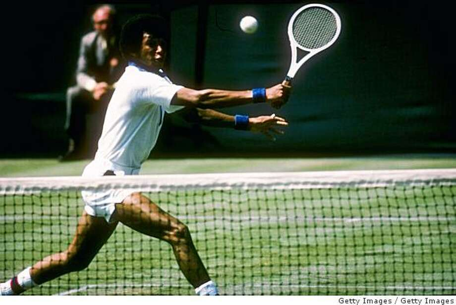 Arthur Ashe runs for the ball during a match at Wimbledon in England. Photo: Getty Images