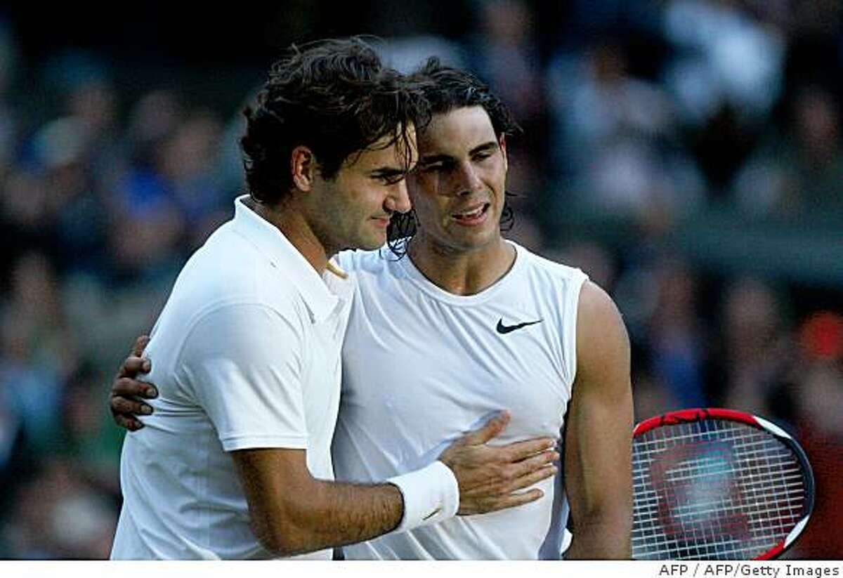 Spain's Rafael Nadal (R) is congratulated by Switzerland's Roger Federer after winning their final tennis match of the 2008 Wimbledon championships against at The All England Tennis Club in southwest London, on July 6, 2008. Nadal won 6-4, 6-4, 6-7, 6-7, 9-7. POOL AFP PHOTO / RYAN PIERSE (Photo credit should read RYAN PIERSE/AFP/Getty Images)