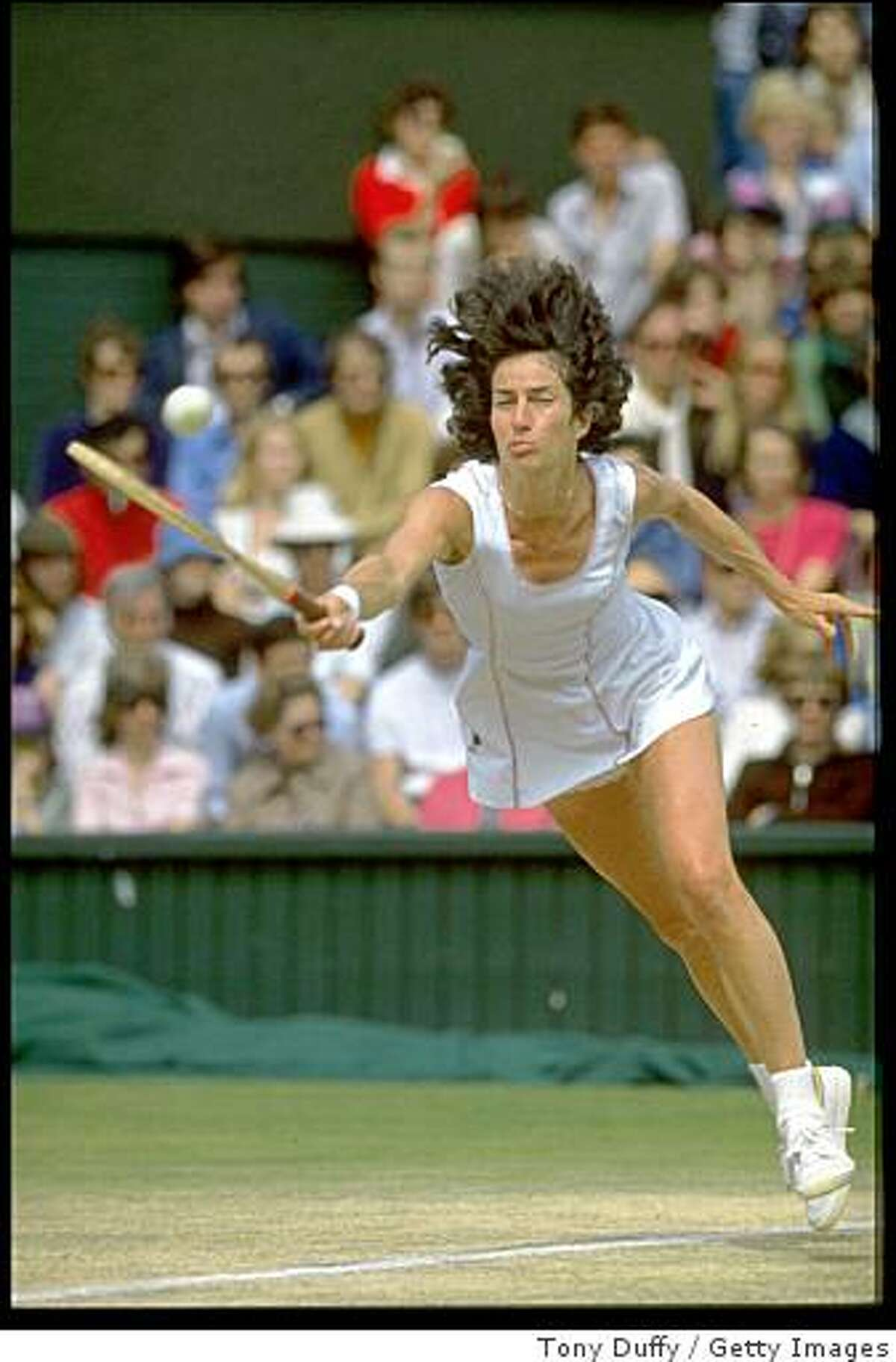 1 JUL 1977: VIRGINIA WADE OF GREAT BRITAIN DIVES TO REACH THE BALL DURING THE LADIES FINAL AT THE 1977 WIMBLEDON TENNIS CHAMPIONSHIPS. WADE DEFEATED BETTY STOVE OF HOLLAND 4-6, 6-3, 6-1.