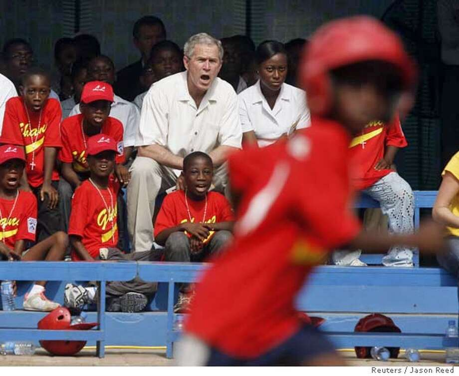 U.S. President George W. Bush reacts as he watches a Ghana Little league T-ball game between the Little Saints (pictured) and the Little Dragons, at the Ghana International School in Accra, February 20, 2008. REUTERS/Jason Reed (GHANA) Photo: JASON REED