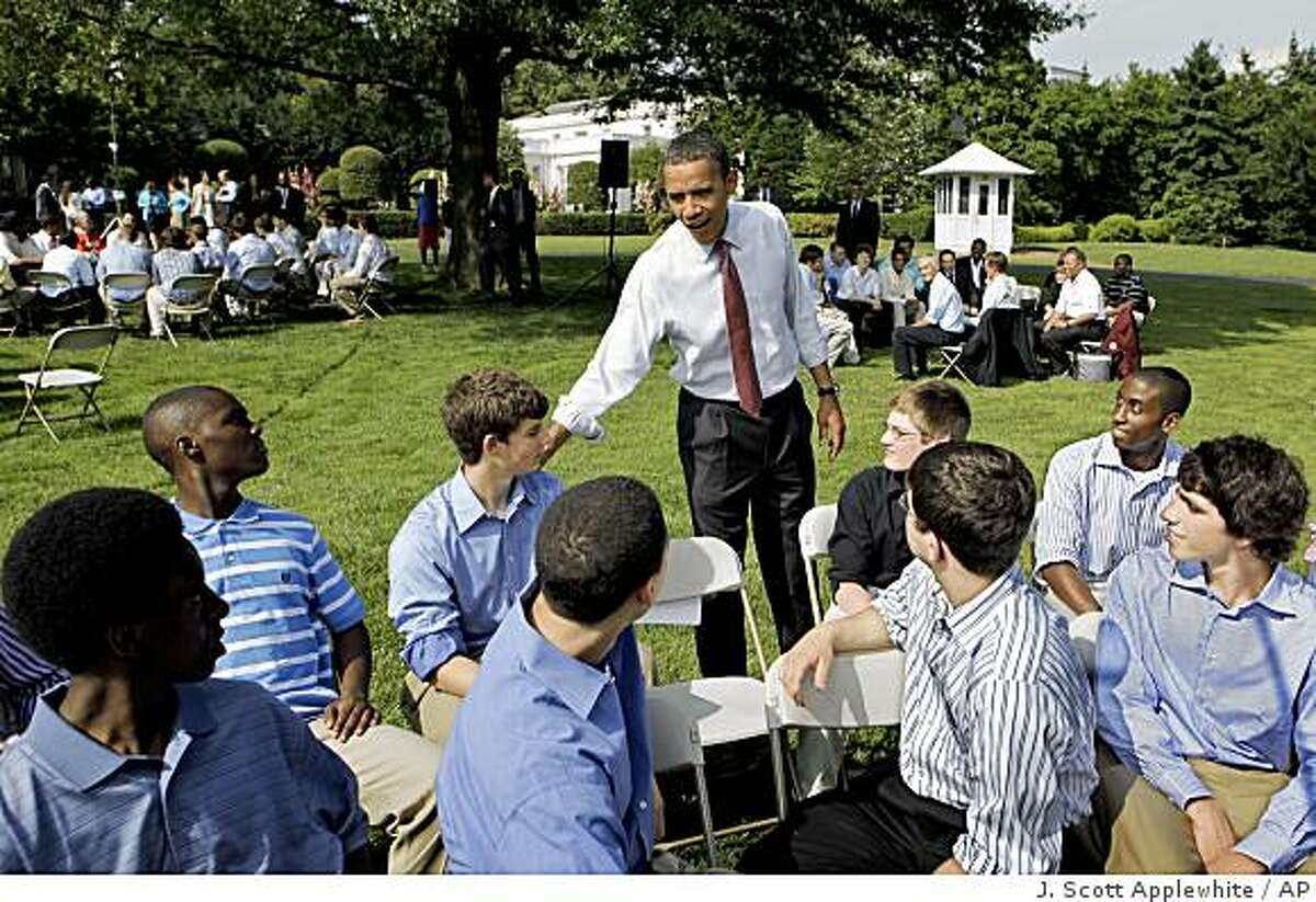 President Barack Obama hosts a cookout on the South Lawn of the White House for young men from local schools, one of several events to stress the importance of being good fathers, in Washington, Friday, June 19, 2009. (AP Photo/J. Scott Applewhite)