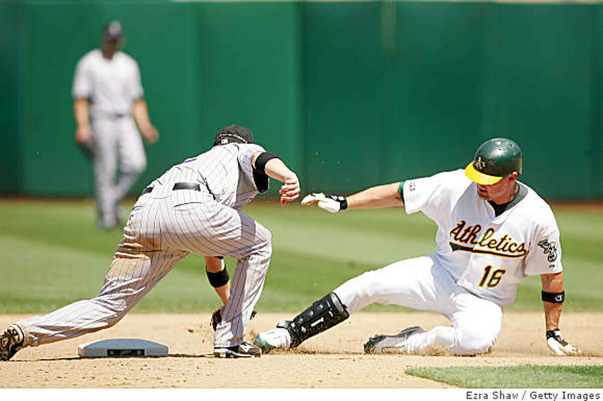 OAKLAND, CA - JUNE 28: Jason Giambi # of the Oakland Athletics is tagged out by Clint Barmes #12 of the Colorado Rockies when he tried to stretch a hit into a double in the eighth inning of their game at the Oakland Coliseum on June 28, 2009 in Oakland, California. (Photo by Ezra Shaw/Getty Images)