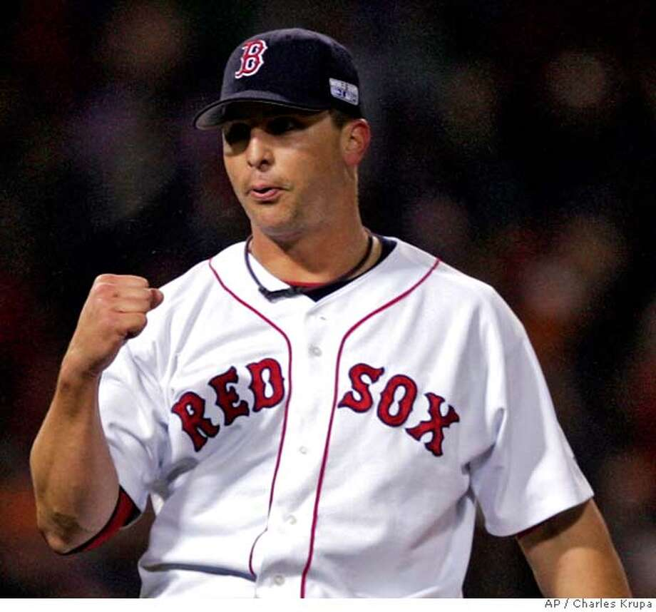 Boston Red Sox relief pitcher Keith Foulke pumps his fist at the end of Game 2 during the World Series in Boston, Sunday, Oct. 24, 2004. The Red sox won 6-2. (AP Photo/Charles Krupa) Ran on: 10-31-2004  Keith Foulke had the support of at least one reader for MVP of the World Series. Ran on: 10-31-2004  Keith Foulke had the support of at least one reader for MVP of the World Series. Photo: CHARLES KRUPA