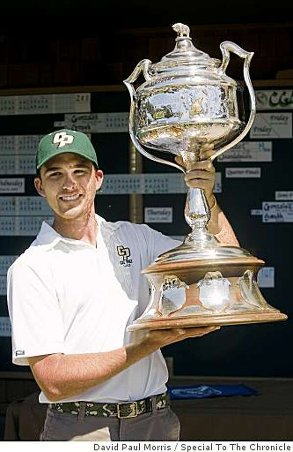 Geoff Gonzalez of Diablo holds up the trophy after beating Jeff Wilson of Fairfield 3 and 2 during the final 36 hole match of the California State Amateur Championship at Lake Merced Golf and Country Club on June 27, 2009 in Daly City, Calif. Photo: David Paul Morris, Special To The Chronicle