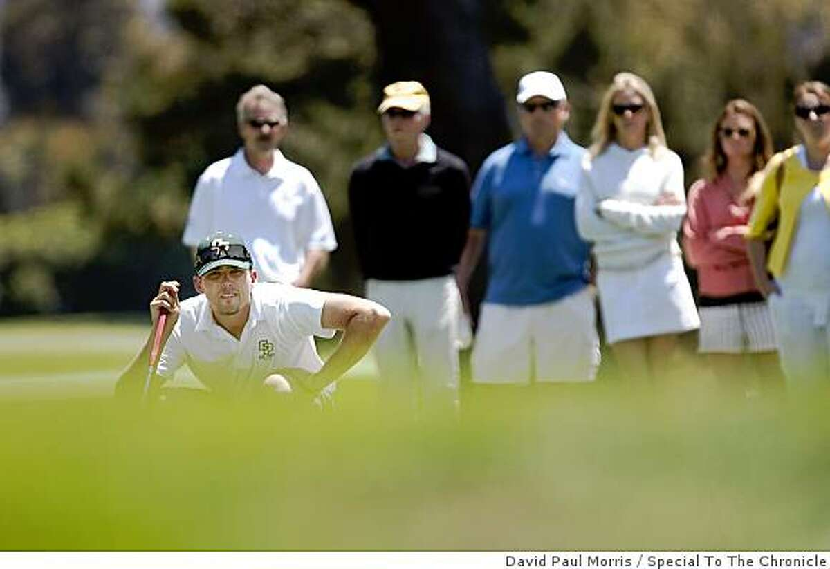 Geoff Gonzalez of Diablo lines up his putt on the 12th hole as the gallery watches during the final round of the California State Amateur Championship at Lake Merced Golf and Country Club on June 27, 2009 in Daly City, Calif.