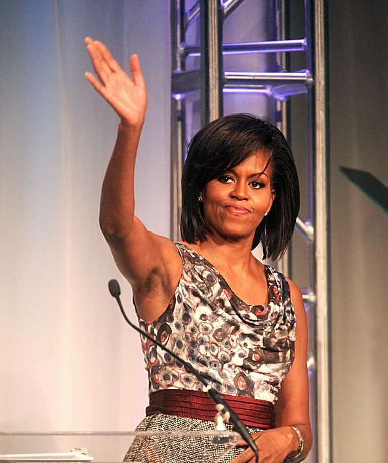 First lady Michelle Obama speaks at the 2009 National Conference on Volunteering and Service on Monday, June 22, 2009, in San Francisco. Obama kicked off President Barack Obama's United We Serve campaign urging people to help the nation's economic recovery through volunteering and public service. Photo: Noah Berger, AP