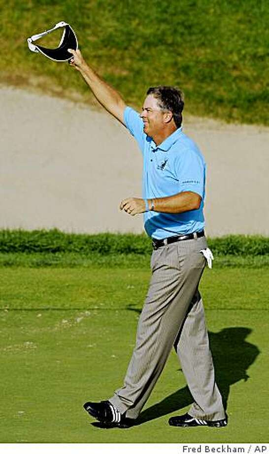 Kenny Perry celebrates after winning the Travelers Championship golf tournament in Cromwell, Conn., on Sunday, June 28, 2009. Perry shot a final round 63 to finish the tournament at 22-under par. (AP Photo/Fred Beckham) Photo: Fred Beckham, AP