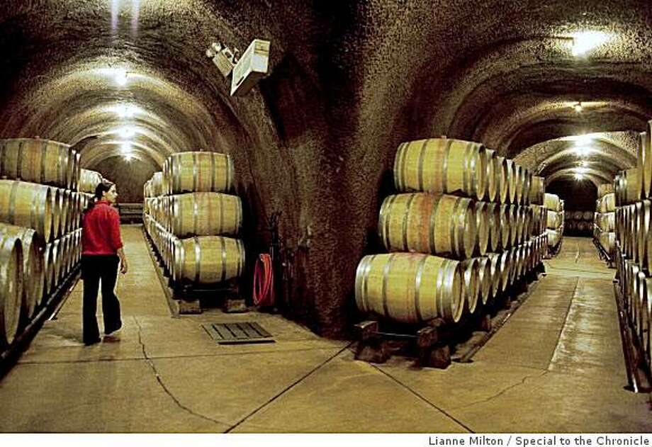 Wine pourer Megan Farley walks through a corridor of the wine cave, which extends a mile into the hillside of the property, at Rombauer Vineyards, in St. Helena, CA., on Saturday, June 6, 2009. Photo: Lianne Milton, Special To The Chronicle