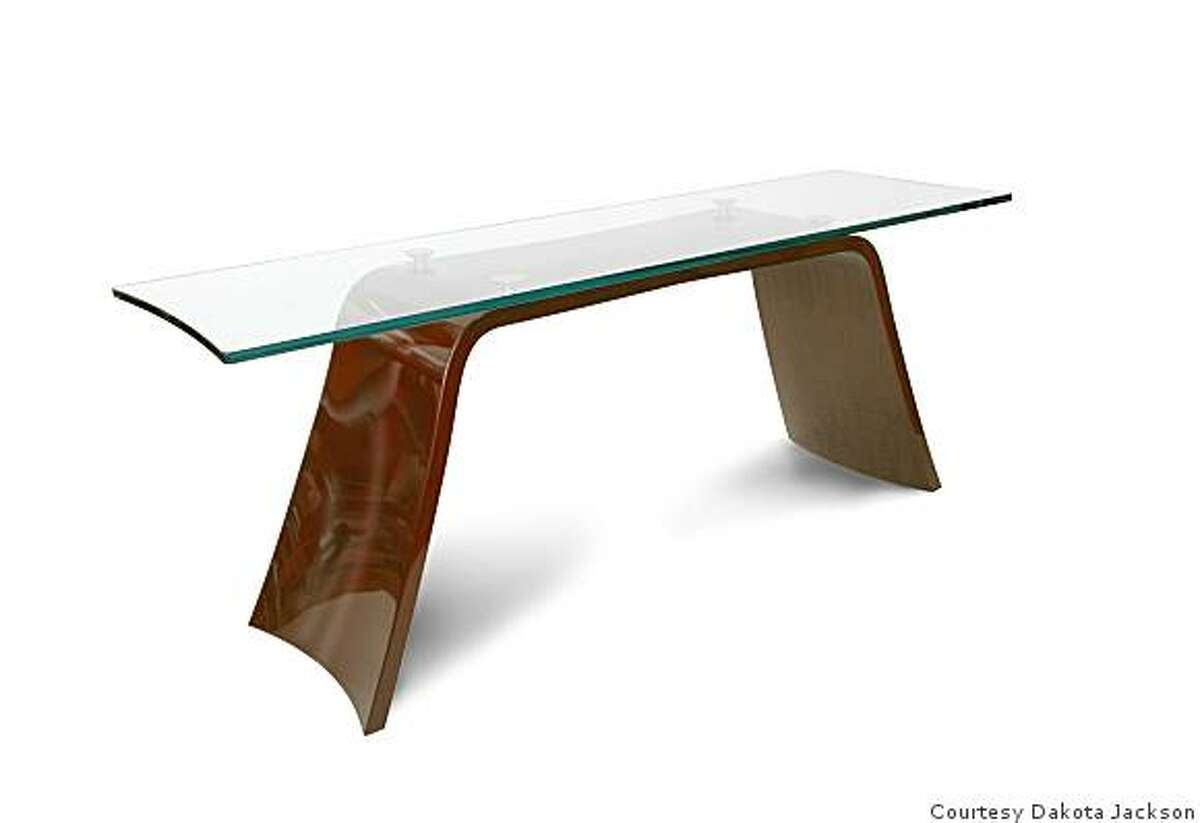 Cascade Console is a multi-planar molded console made of laminated strips of maple veneer. It is shaped to resmble cascading water. the top is made of temepered glass.
