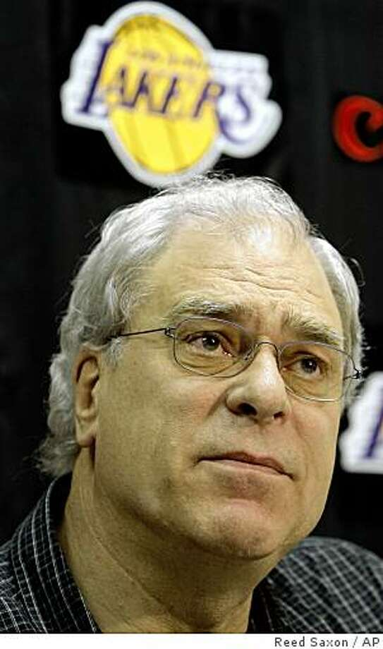 Los Angeles Lakers head coach Phil Jackson speaks to reporters following the Lakers' winning the NBA basketball championship, at team headquarters in El Segundo, Calif., Friday, June 19, 2009.  (AP Photo/Reed Saxon) Photo: Reed Saxon, AP