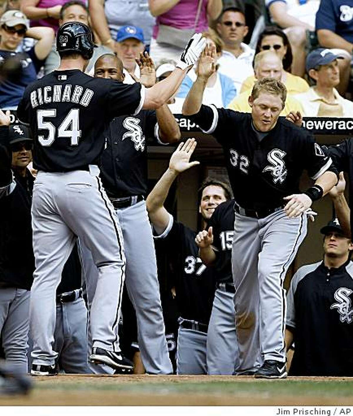 Chicago White Sox's Clayton Richard (54) is congratulated by teammates after scoring the game winning run on a single by teammate A.J. Pierzynski during the ninth inning of a baseball game Sunday, June 14, 2009, in Milwaukee. The White Sox defeated the Brewers 5-4. (AP Photo/Jim Prisching)