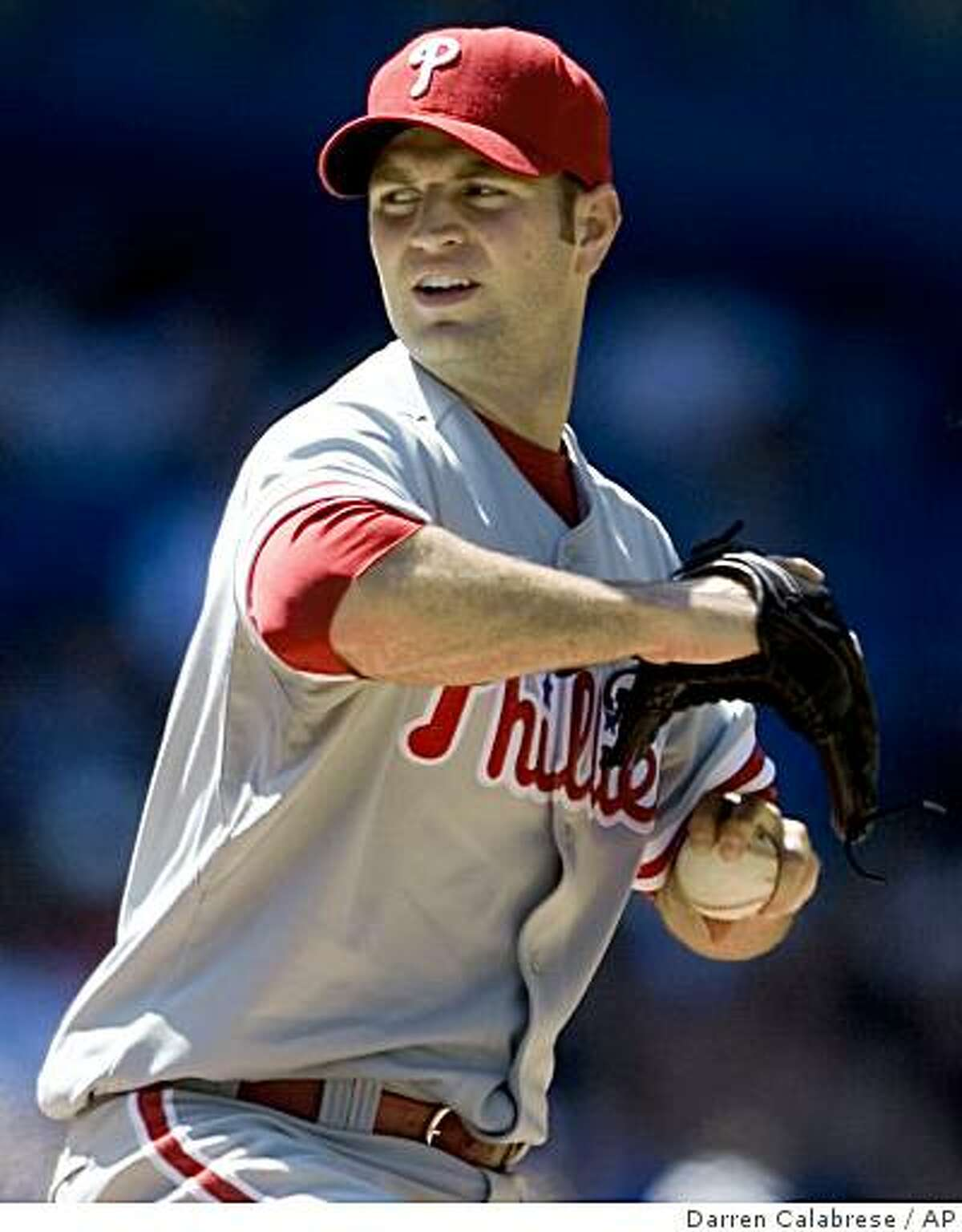 Philadelphia Phillies pitcher J. A. Happ pitches against the Toronto Blue Jays during ninth-inning baseball action in Toronto on Saturday, June 27, 2009. (AP Photo/The Canadian Press, Darren Calabrese)