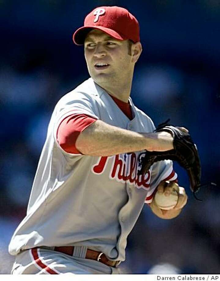 Philadelphia Phillies pitcher J. A. Happ pitches against the Toronto Blue Jays during ninth-inning baseball action in Toronto on Saturday, June 27, 2009. (AP Photo/The Canadian Press, Darren Calabrese) Photo: Darren Calabrese, AP