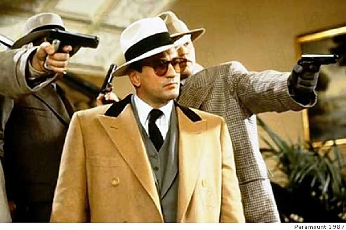 Robert De Niro as Al Capone in