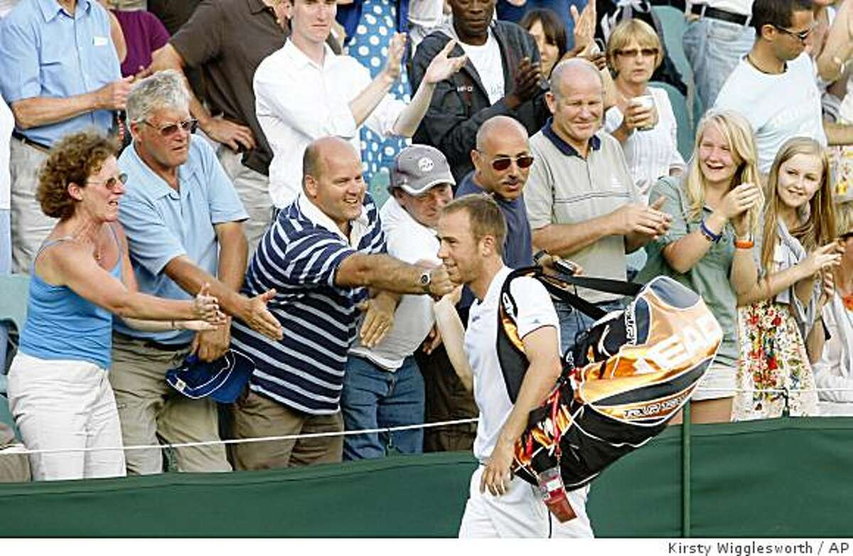 Dudi Sela of Israel is aqpplauded by spectators, after defeating Tommy Robredo of Spain, in their third round men's singles match at Wimbledon, Friday, June 26, 2009. (AP Photo/Kirsty Wigglesworth)