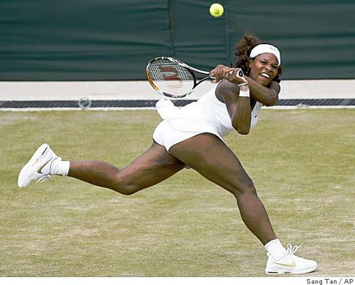 Serena Williams of U.S. plays a return to Roberta Vinci of Italy during their third round singles match at Wimbledon, Friday, June 26, 2009. (AP Photo/Sang Tan)