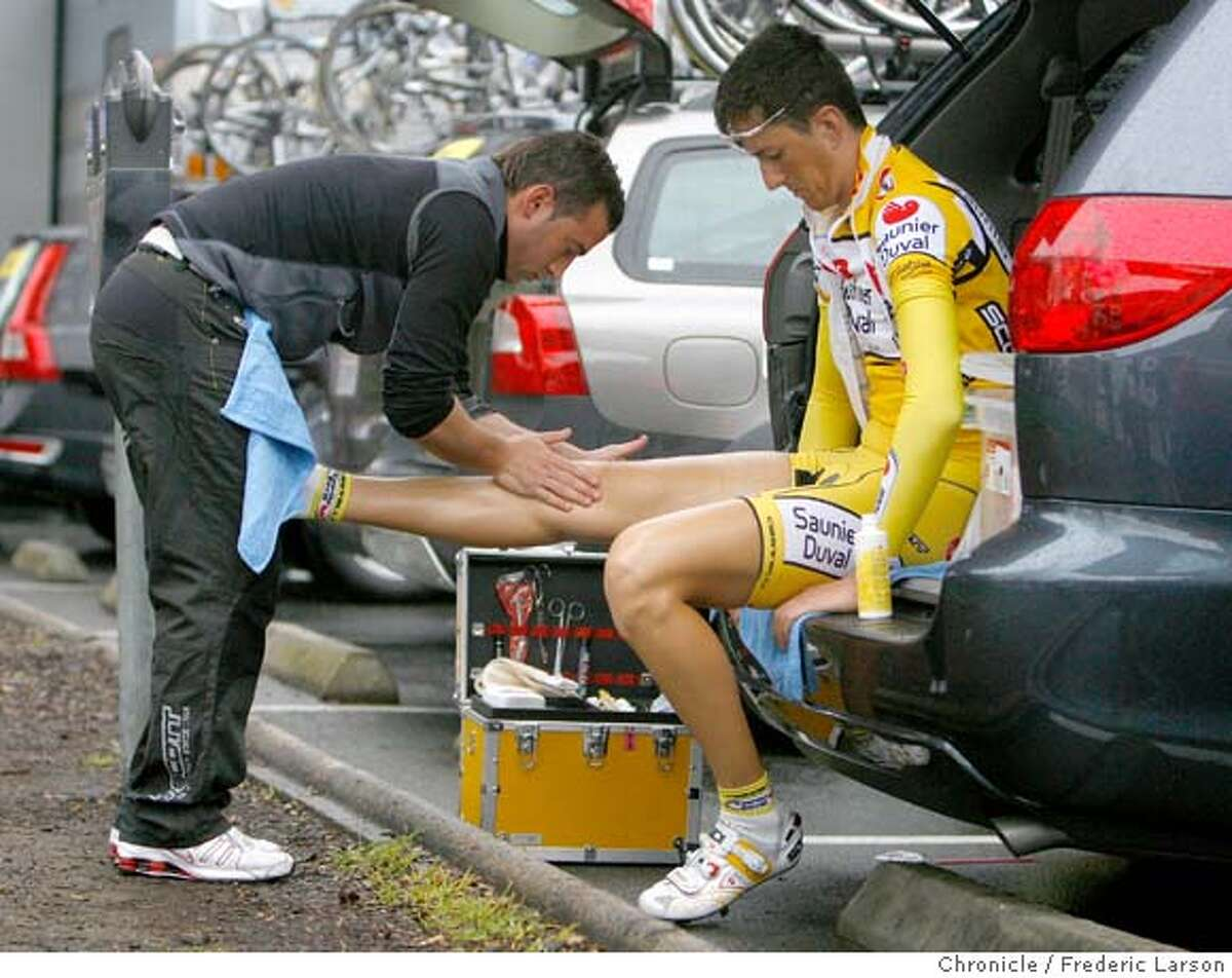 Cyclist of Italy Emmanno Capelli gets his legs rubbed down before the race by Marliaro Carmine (left) in preparation for the 2nd stage of the Amgen Tour of California bike race that was from Rail Square on 4th and Davis Streets of Santa Rosa to Sacramento.