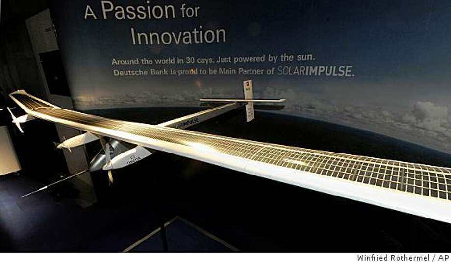 View of a model of the airplane Solar Impulse on Friday, June 26, 2009,  in Zurich-Duebendorf , Switzerland. The innovative  plane is created to fly around the world  powered entirely by  solar energy. With  lithium batteries  it will be capable of flying  at night as well.  Solar Impulse looks like a  glider with the wingspan of 63 meters (207 feet).  The wings will be covered with 250 square meters  of solar-cells. The airplane is scheduled to take off in 2012, with stops on every continent. (AP Photo/Winfried Rothermel) Photo: Winfried Rothermel, AP