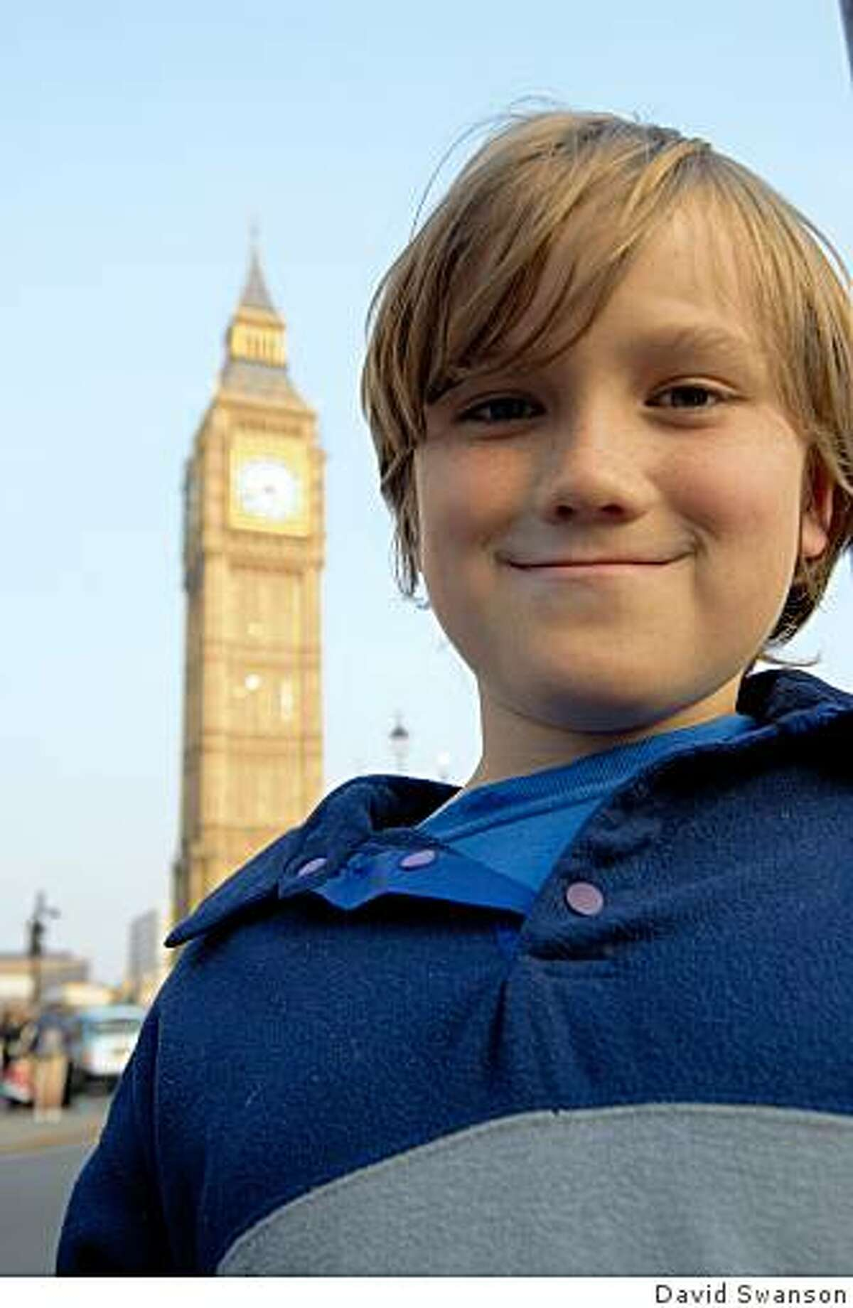 Julian in front of Big Ben, the clock rising above the Palace of Westminster.