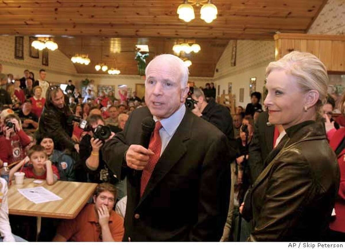 Republican presidential hopeful, Sen. John McCain, R-Ariz., left, accompanied by his wife Cindy, addresses a packed house at Young's Jersey Dairy restaurant, Wednesday, Feb. 20, 2008, in Yellow Springs, Ohio. (AP Photo/Skip Peterson)