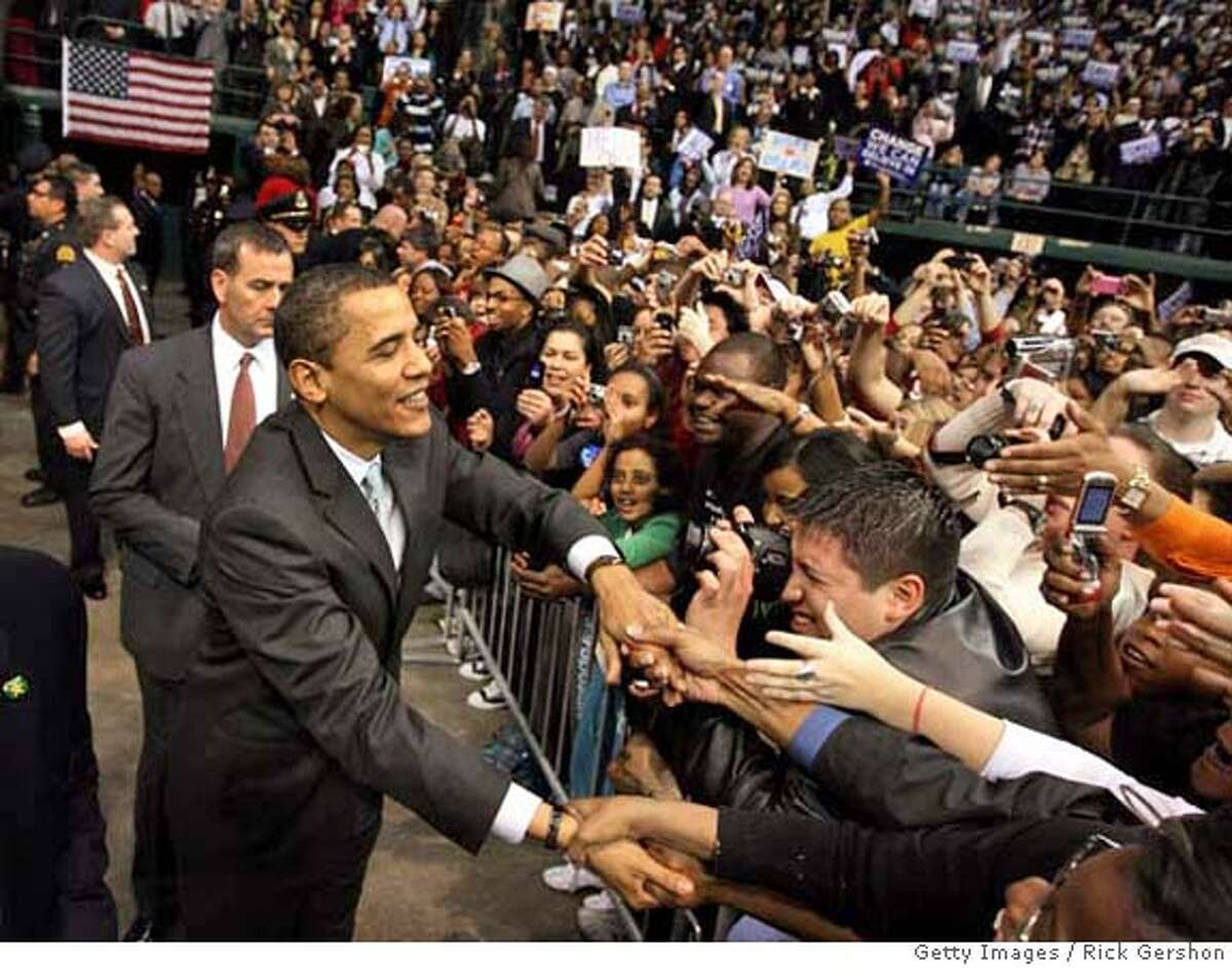 DALLAS - FEBRUARY 20: Democratic presidential hopeful Sen. Barack Obama (D-IL) greets supporters during a rally February 20, 2008, at Reunion Arena in Dallas, Texas. Obama is coming off of his 10th consecutive win and is hoping to take Texas and Ohio in their upcoming primaries. (Photo by Rick Gershon/Getty Images)