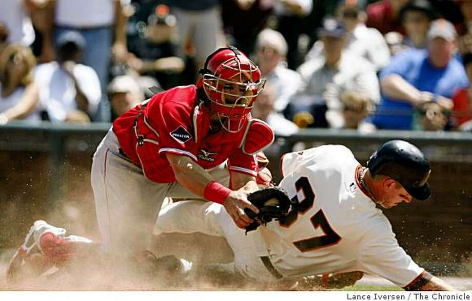 Los Angeles Angels catcher Jeff Mathis puts a tag on Giants Matt Downs in the 7th inning after Downs advanced on an Edgar Renteria from second base. The Angels defeated the San Francisco Giants in their third game of the series 4-3 at AT&T Park in San Francisco Wednesday June 17, 2009 Photo: Lance Iversen, The Chronicle