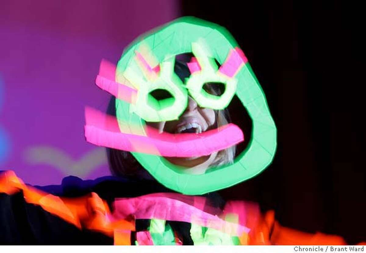 Sia's first song of the night about ghosts. She and the band wore masks and glowing Halloween-like outfits. Sia and her band performed at the Fillmore in San Francisco. (Photo by Brant Ward/San Francisco Chronicle)