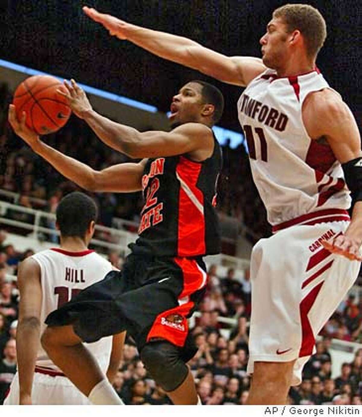 Oregon State's Calvin Haynes goes up for a shot as Stanford's Brook Lopez guards during the first half of a basketball game Saturday, Feb. 9, 2008, in Stanford, Calif. (AP Photo/George Nikitin)