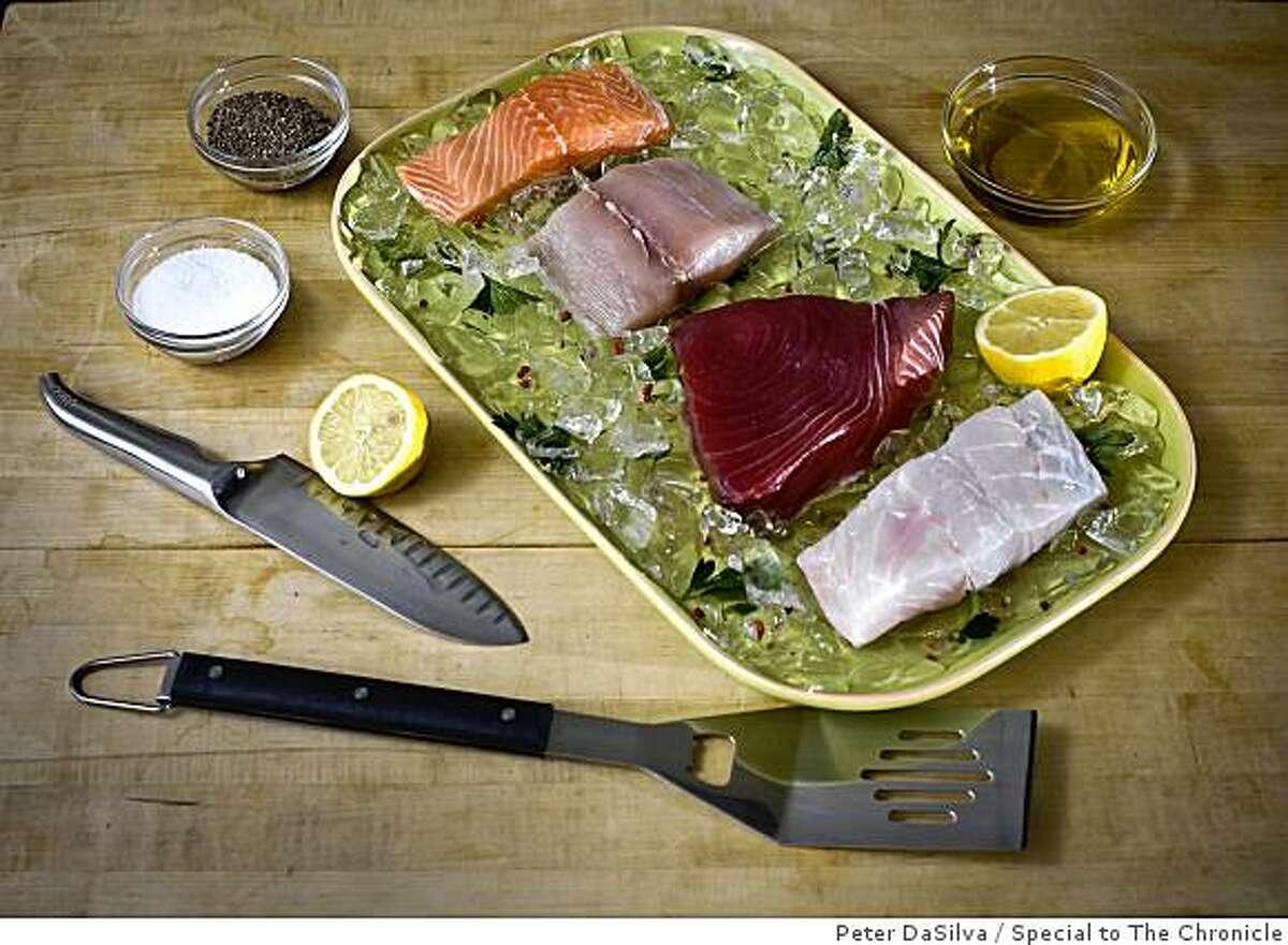 Raw fish fillets for grilling; salmon, mahimahi, tuna and grouper (top-bottom) on Jun. 19, 2009.