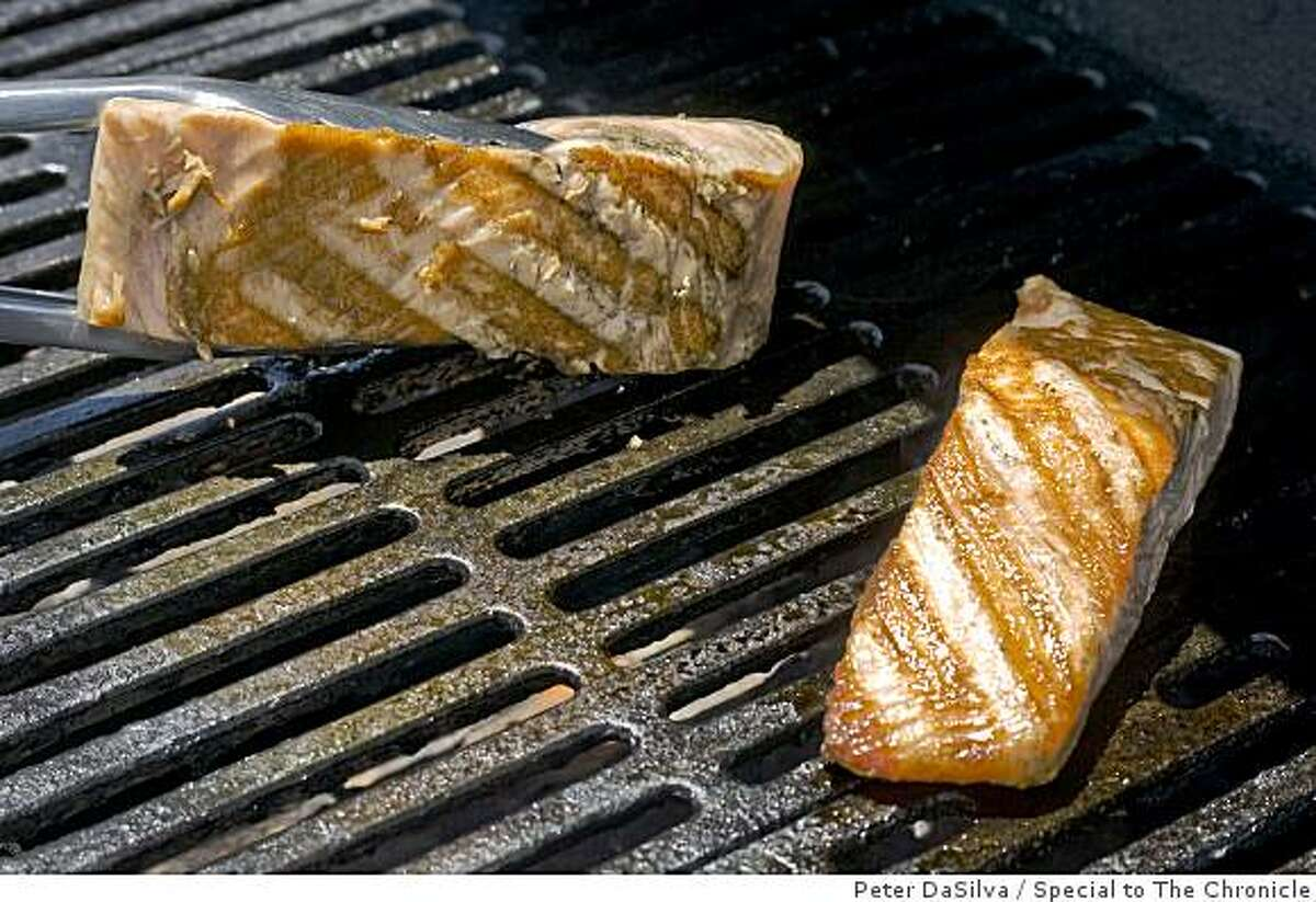 Salmon fish fillets on the grill on Jun. 19, 2009.