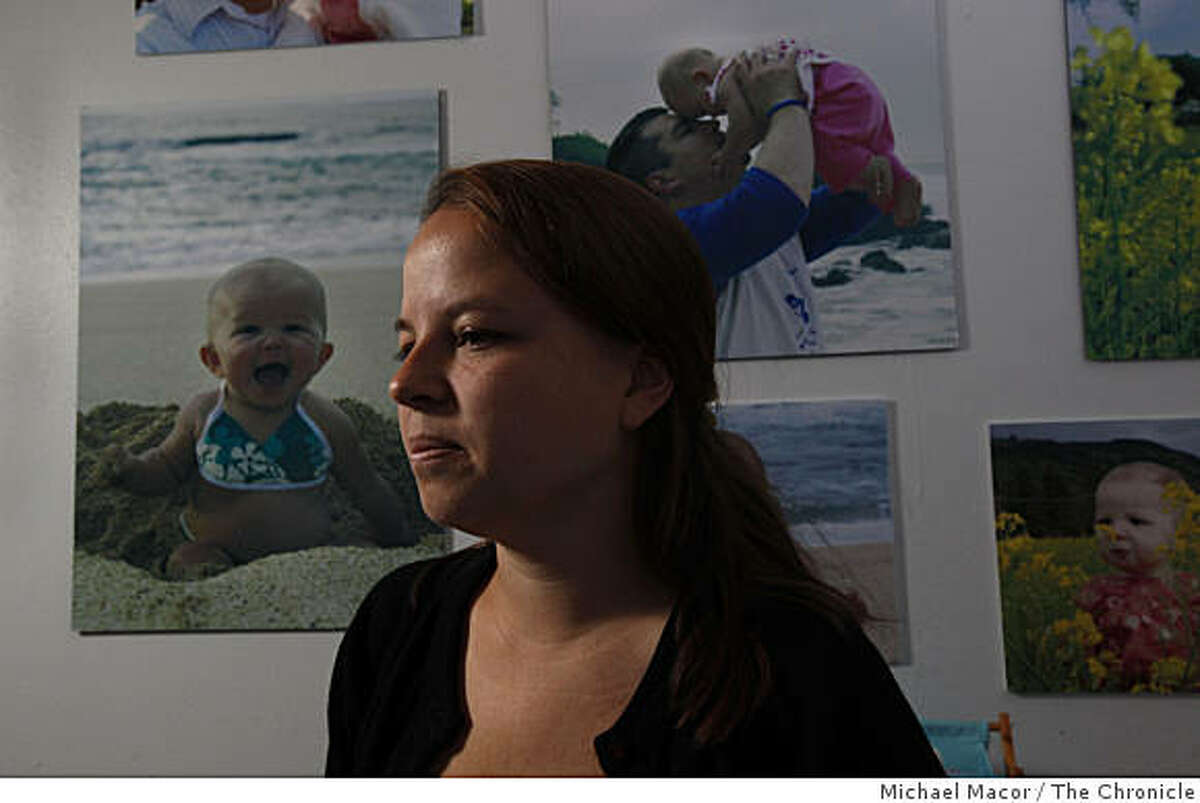 Haley Wesley near photographs in the children's room, of her two daughters, Maddison, (left and top row) and Peyton (bottom right). Wesley, who in May of 2007 accidentally left her 10-month old daughter Maddison in her car seat in the back seat of her vehicle which resulted in the child's death. Wesley at her home in Angwin, Calif. on Thursday June 11, 2009.