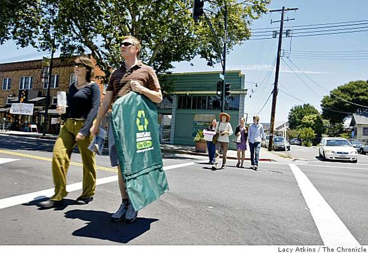 People walk along Telegraph Avenue through the Temescal neighborhood, Thursday, June 25, 2009, in Oakland, Calif.