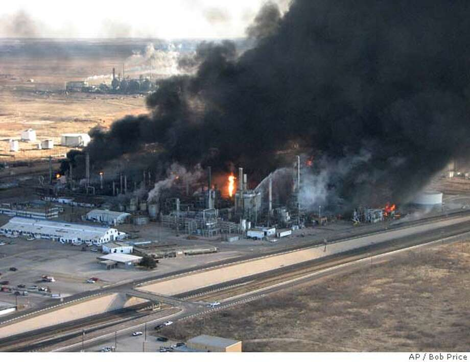 ** FILE ** Plumes of smoke rise after an explosion at an Alon USA oil refinery in Big Spring, Texas in this Monday, Feb. 18, 2008 file photo. The explosion in Texas and the possibility that OPEC will cut production next month are driving prices higher, although analysts say there isn't a single factor to explain the move. (AP Photo/Bob Price, file) Photo: Bob Price