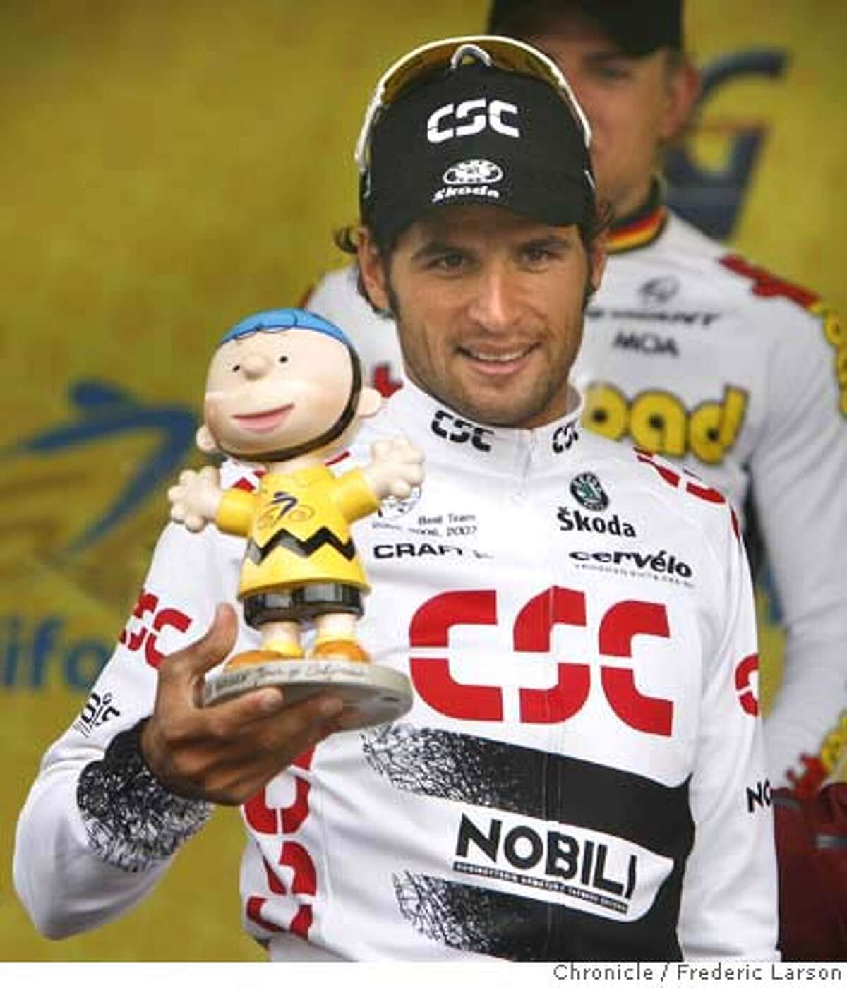J.J (Juan Jose) Haedo of Argentina wins the second stage of Amgen Tour of California from Sausaulito crossing the finish line in Santa Rosa and receives a Charlie Brown trophy.