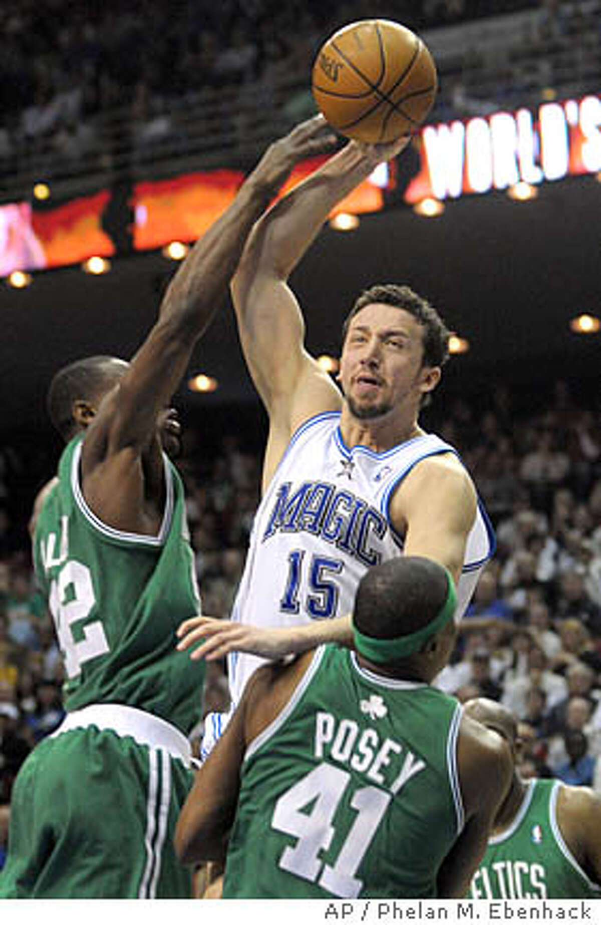 ** FILE ** Orlando Magic forward Hedo Turkoglu, center, of Turkey, puts up a shot over Boston Celtics forward James Posey (41) and Tony Allen, left, during the first half of an NBA basketball game in this file photo from Orlando, Fla., Sunday, Jan. 27, 2008. Turkoglu is in his eighth season in the league, and the 6-foot-10 forward is a back reason why the Magic have become one of the Eastern Conference's top team. (AP Photo/Phelan M. Ebenhack,file)