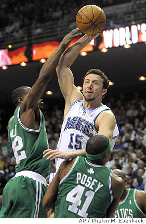 ** FILE ** Orlando Magic forward Hedo Turkoglu, center, of Turkey, puts up a shot over Boston Celtics forward James Posey (41) and Tony Allen, left, during the first half of an NBA basketball game in this file photo from Orlando, Fla., Sunday, Jan. 27, 2008. Turkoglu is in his eighth season in the league, and the 6-foot-10 forward is a back reason why the Magic have become one of the Eastern Conference's top team. (AP Photo/Phelan M. Ebenhack,file) Photo: Phelan M. Ebenhack