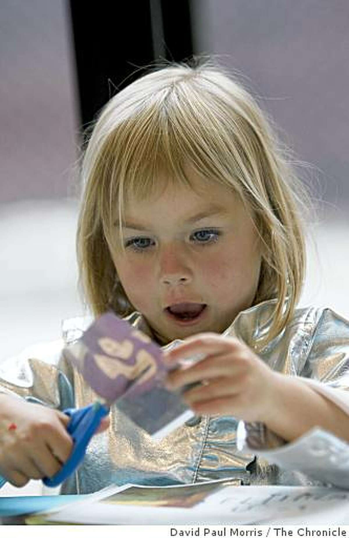 Delilah Kaden, 3 1/2 from San Francisco cuts out paper pictures during cultural encounters Friday Nights at the de Young Museum in Golden Gate Park May 29, 2009 in San Francisco, Calif. (Photograph by David Paul Morris/The Chronicle)
