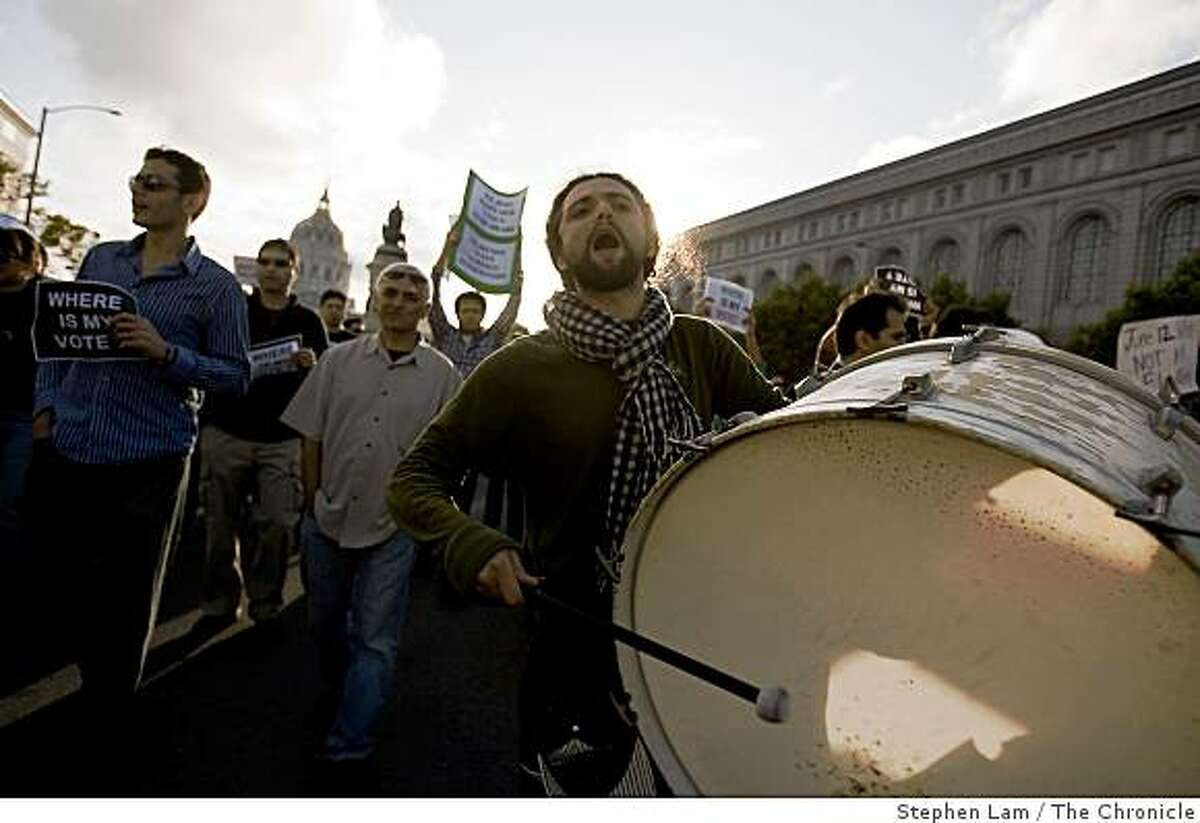 Shahab, last name withheld, center, chants along with a group of demonstrators in protest of Iran's election result in San Francisco on Saturday.