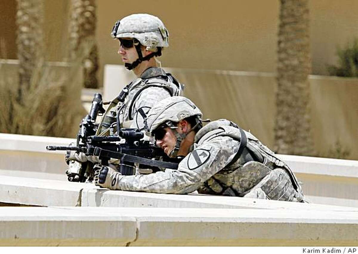 ** CORRECTS THE FACT BAGHDAD ISLAND WAS BASED ON A DESIGN BY FRANK LLOYD WRIGHT ** U.S. Army soldiers provide security at a groundbreaking ceremony for the revitalization of Baghdad Island, built in the 1980s and based on a design by Frank Lloyd Wright in Baghdad, Iraq, Monday, June 22, 2009. U.S. and Iraqi officials have begun renovating an amusement park on an island north of Baghdad. It's the latest effort to restore a sense of normalcy amid security gains and reflects a U.S. focus on civil affairs projects ahead of next week's deadline for combat troops to withdraw from cities. The 150-acre Tigris River complex was a popular site for weddings and other celebrations before the U.S.-led invasion in March 2003. But it was devastated by looting in the aftermath. (AP Photo/Karim Kadim)