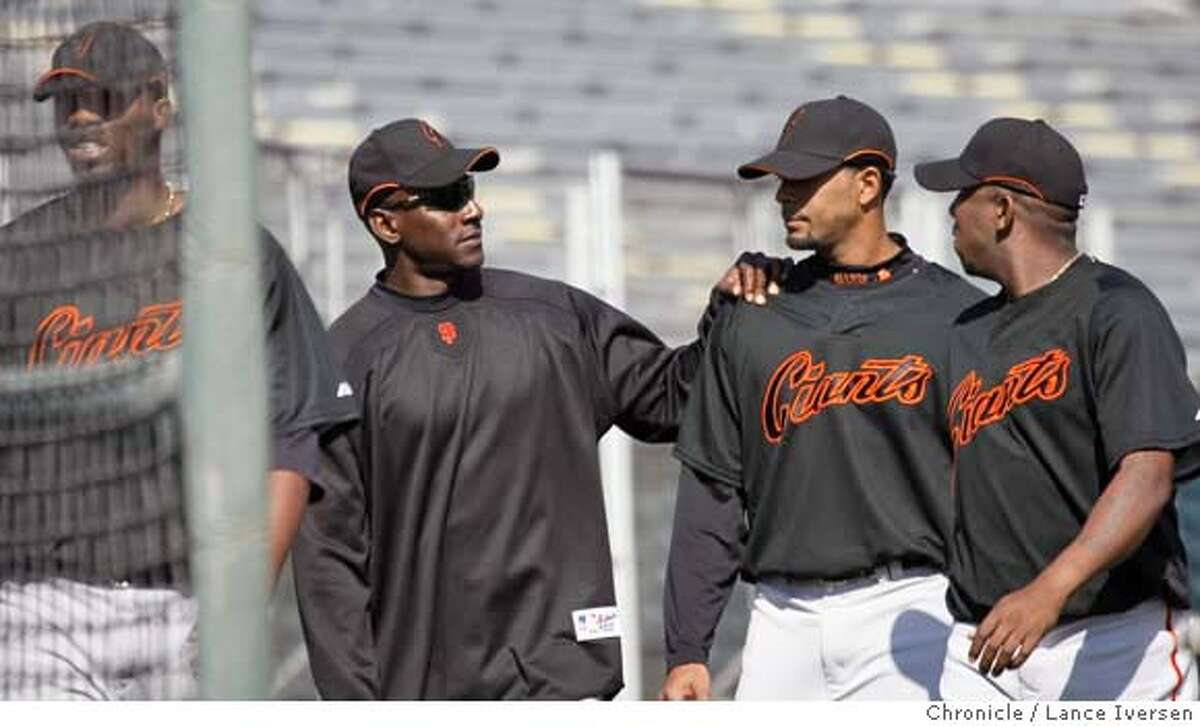 San Francisco Giants base running coach Robert Kelly puts his hand on the shoulder of #54 Victor Santos at the end of his base running clinic for pitchers Sunday at Scottsdale Stadium. Home of the Giants during spring training workouts in Scottsdale, Ariz. By Lance Iversen/The San Francisco Chronicle MANDATORY CREDIT PHOTOG AND SAN FRANCISCO CHRONICLE/NO SALES MAGS OUT