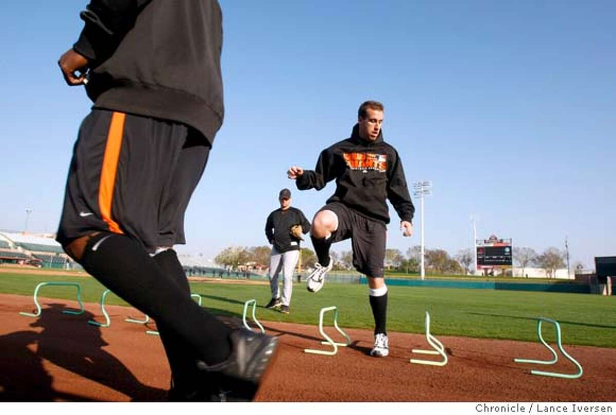 San Francisco Giants pitchers and catchers take part in drills in the outfield at Scottsdale Stadium during their spring training baseball workouts Sunday in Scottsdale, Ariz. By Lance Iversen/The San Francisco Chronicle