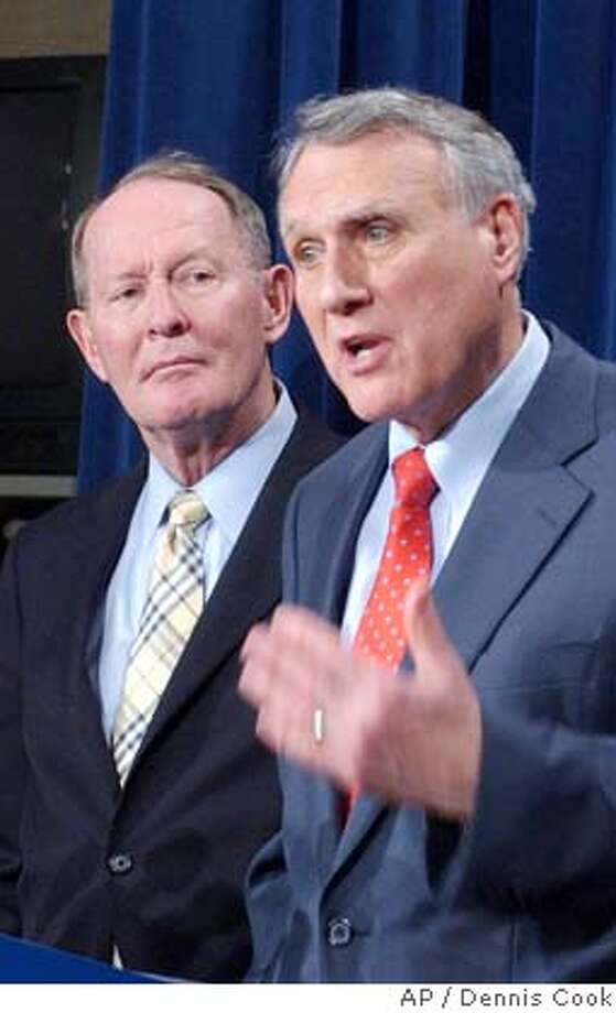 Sen. Jon Kyl, R-Ariz., talks to reporters in Washington Wednesday, Feb. 6, 2008, after after a cloture vote on an economic stimulus package failed to pass. Sen. Lamar Alexander, R-Tenn., is at left. (AP Photo/Dennis Cook) Photo: Dennis Cook