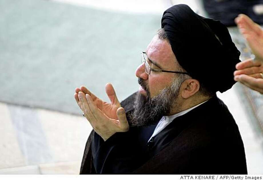 "Senior Iranian hardline cleric Ayatollah Ahmad Khatami leads the weekly Friday prayer at Tehran University on June 26, 2009. Khatami urged the government on Friday to ""better control"" the foreign media, accusing them of fomenting the protests over this month's presidential election. AFP PHOTO/ATTA KENARE (Photo credit should read ATTA KENARE/AFP/Getty Images) Photo: ATTA KENARE, AFP/Getty Images"