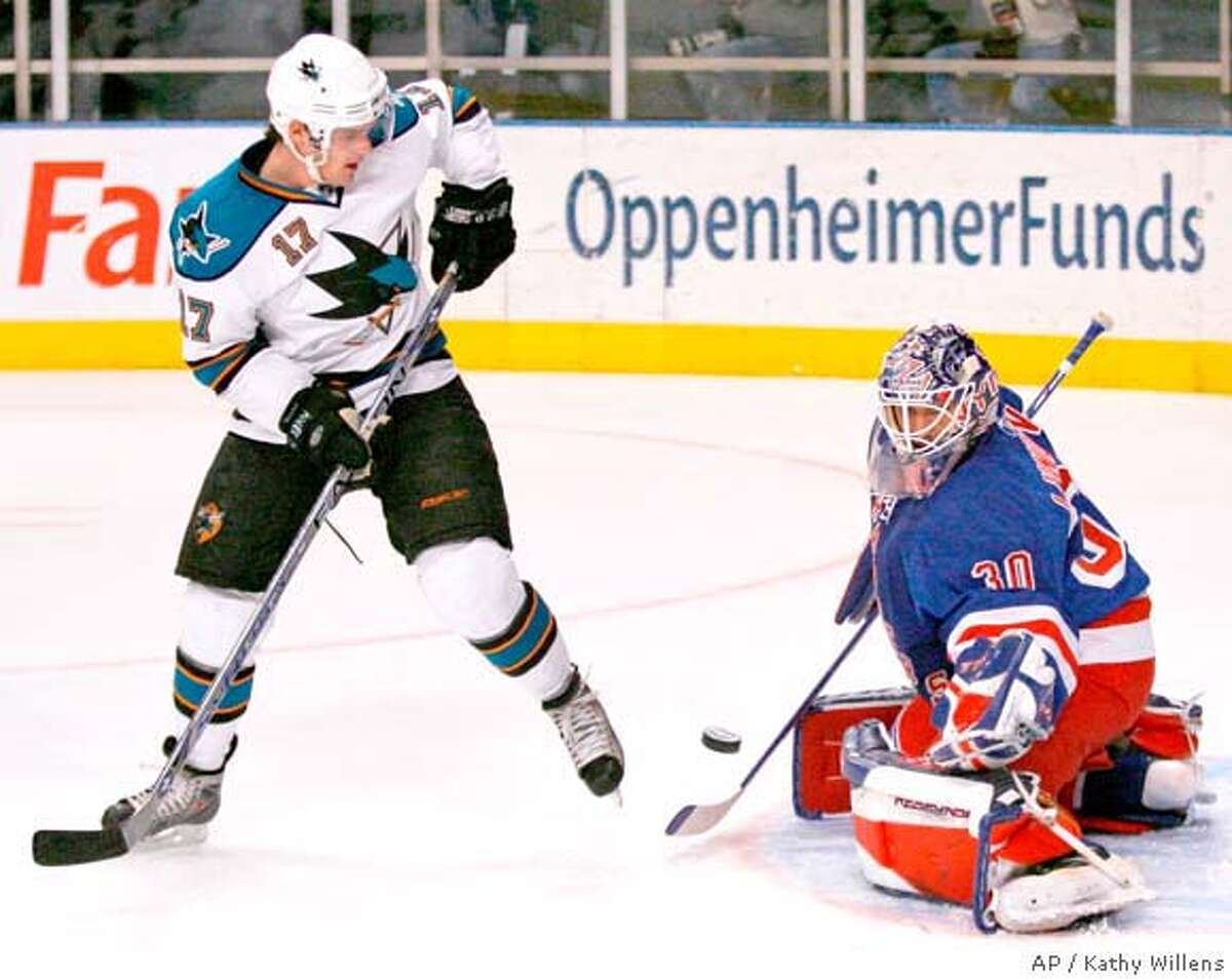 New York Rangers goalie Henrik Lundqvist (30) of Sweden, blocks a shot by San Jose Sharks center Torrey Mitchell (17) in the first period of an NHL hockey game at Madison Square Garden in New York, Sunday, Feb. 17, 2008. (AP Photo/Kathy Willens)
