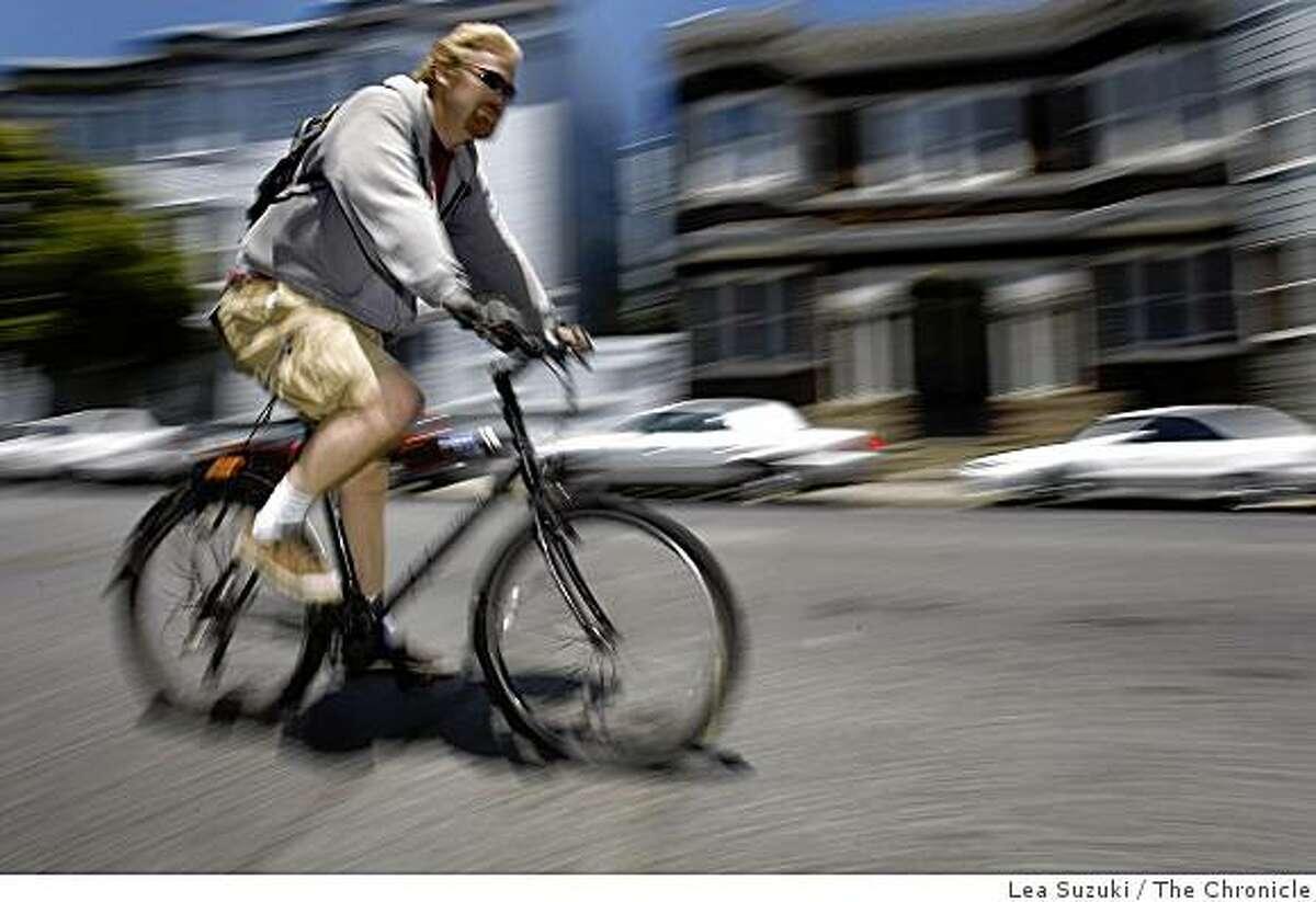 Garrett Johnson of San Francisco rides his bike down 17th street near Dolores street on Tuesday June 23, 2009 in San Francisco, Calif.