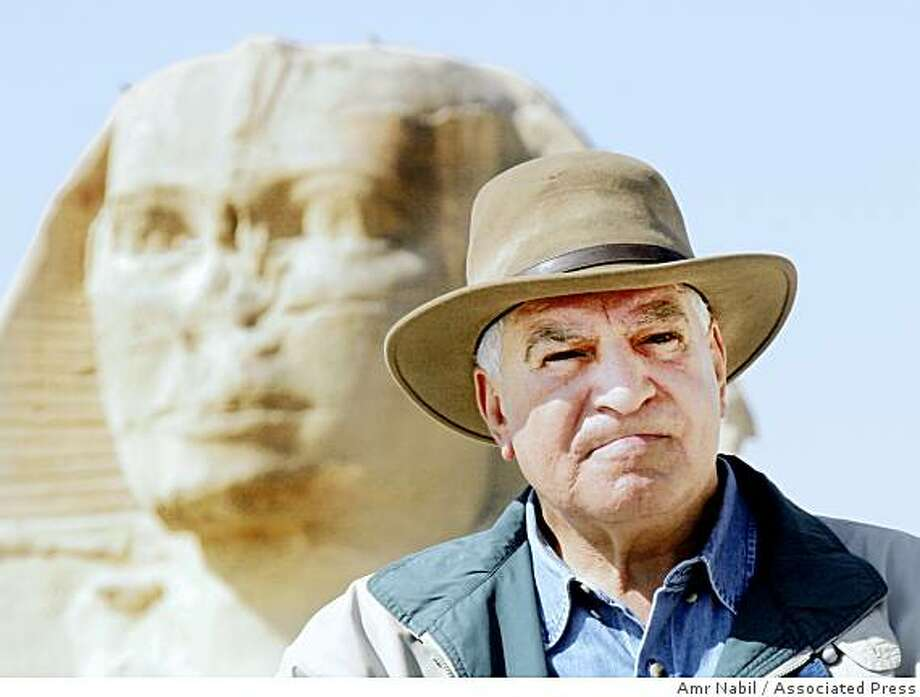 Zahi Hawass, general secretary of the Superior Council of Antiquities of the Egyptian government, poses in front of Sphinx in Giza, Egypt, in this March 3, 2007 file photo. Photo: Amr Nabil, Associated Press