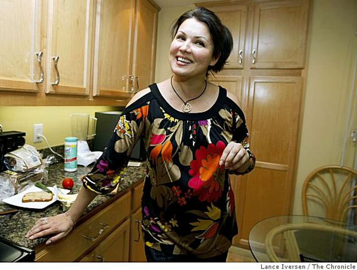 Opera superstar soprano Anna Netrebko, who is visiting SF Opera to perform in La Traviata plays chats with guest as she makes breakfast in her San Francisco apartment Saturday June 5. 2009