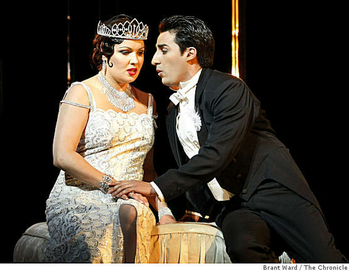 """Anna Netrebko as Violetta (left) and Charles Castronovo as Alfredo in a scene from Act One. San Francisco opera concludes their summer season with Verdi's """"La Traviata"""" at the War Memorial Opera House."""