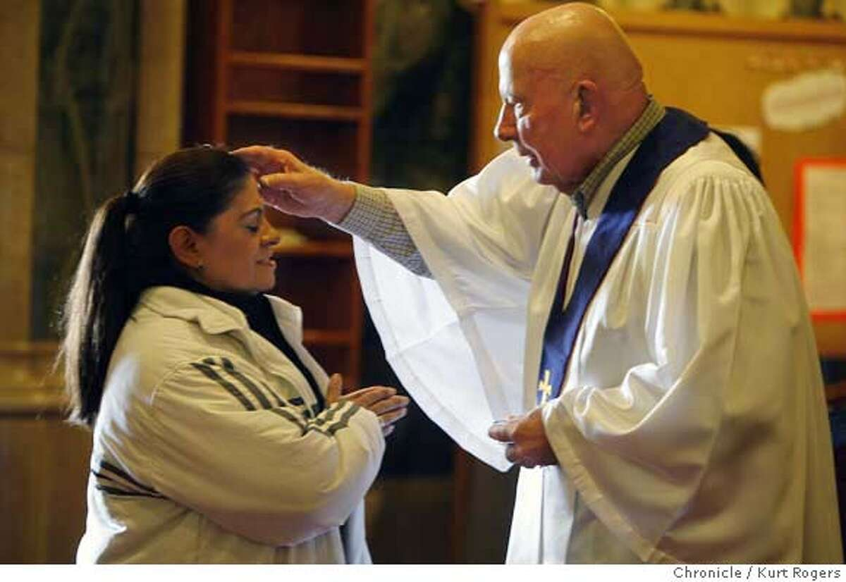(R) Lorrin Kroska (cq) who is a lector at St Patrick's church upts ashes on Hortensia Dasilva (cq) during the Ash Wednesday service. Ash Wednesday at St Patrick's Catholic Church on Mission Street in San Francisco. Ash Wednesday is the first day of Lent and occurs forty ays before Easter. Kurt Rogers / The Chronicle MANDATORY CREDIT FOR PHOTOG AND SAN FRANCISCO CHRONICLE/NO SALES-MAGS OUT